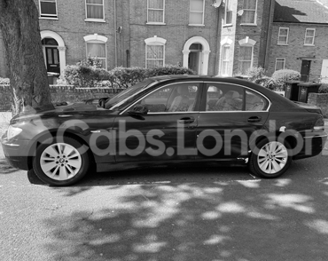 Taxi To Woking From London